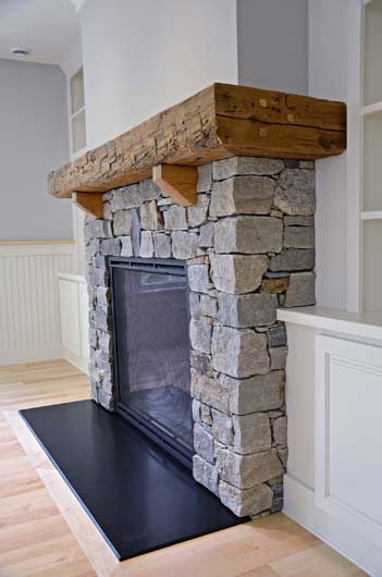 Greg Fitzpatrick Inc - Custom Home Builder - Stone Fireplace with Barn Beam Mantel
